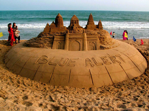 Internationally acclaimed sand sculptor, Sudarshan Patnaik, creates a  7 ft high sculpture of heritage monuments: the Jagannath temple and  Konark Sun Temple in Orissa, the Shore temple at Mammalapuram in  Tamilnadu, and the Gateway of India at Mumbai in the tidal zone of  Puri's Golden Beach.
